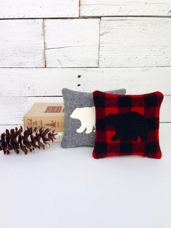 """""""Plaid is a telltale sign of cabin decor, and these checkered balsam pillows are the perfect addition to create the look,"""" Johnson says. <a href=""""https://www.etsy.com/listing/477698240/black-bear-decor-balsam-pillow-rustic"""" target=""""_blank"""">Shop them here</a>."""