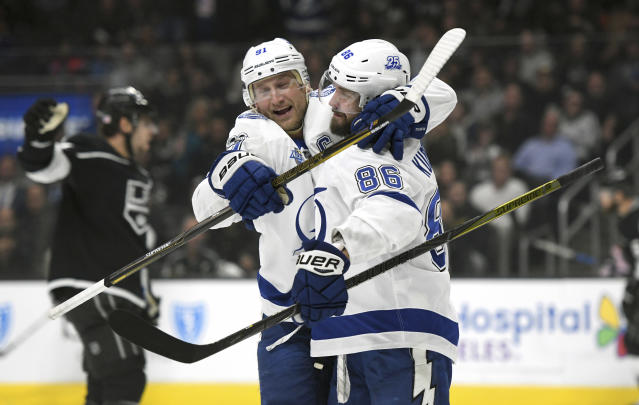 "<a class=""link rapid-noclick-resp"" href=""/nhl/teams/tam/"" data-ylk=""slk:Tampa Bay Lightning"">Tampa Bay Lightning</a> right wing Nikita Kucherov, right, of Russia, is congratulated by center <a class=""link rapid-noclick-resp"" href=""/nhl/players/4471/"" data-ylk=""slk:Steven Stamkos"">Steven Stamkos</a> after scoring against the <a class=""link rapid-noclick-resp"" href=""/nhl/teams/los/"" data-ylk=""slk:Los Angeles Kings"">Los Angeles Kings</a> during the first period of an NHL hockey game, Thursday, Nov. 9, 2017, in Los Angeles. (AP Photo/Michael Owen Baker)"