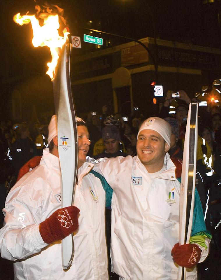 """Canadian crooner Michael Buble proudly carried the Olympic Flame during one of the last legs of the Vancouver 2010 Torch Relay. """"I've got goosebumps and I'm a guy who doesn't get nervous for a lot of things,"""" said Buble of the honor. George Pimentel/<a href=""""http://www.wireimage.com"""" target=""""new"""">WireImage.com</a> - February 11, 2010"""