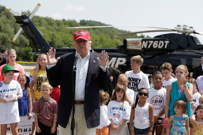 Presidential candidate Donald Trump talks to the media in Des Moines after arriving by helicopter and before attending the Iowa State Fair on Aug. 15, 2015. (Photo: Charlie Riedel/ASSOCIATED PRESS)