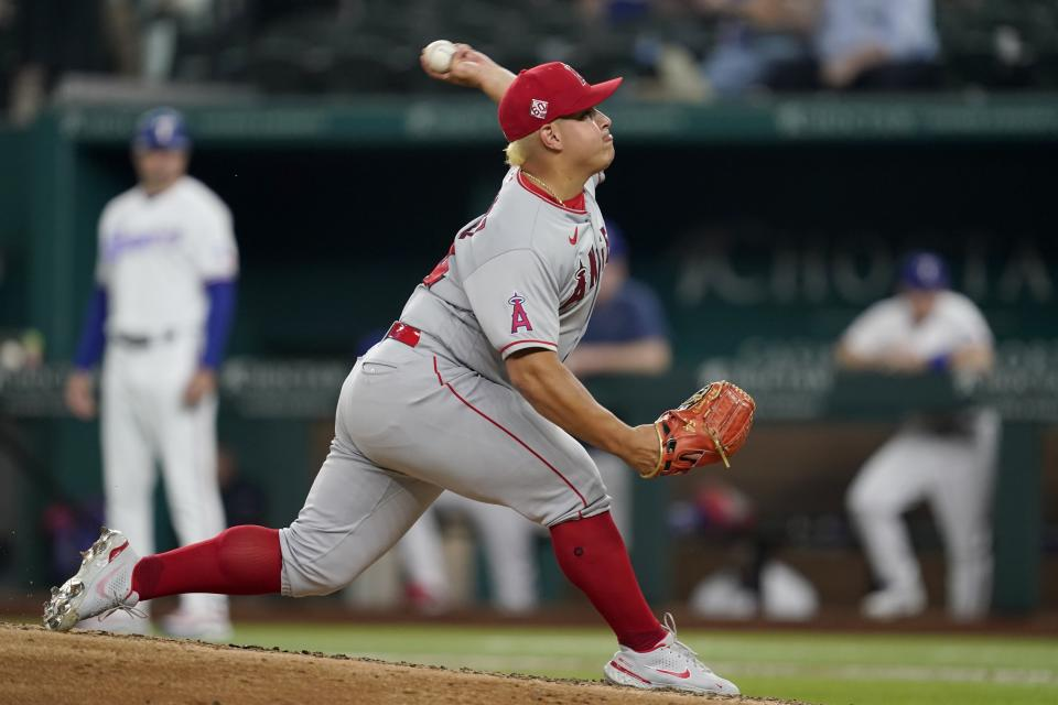 Los Angeles Angels starting pitcher Jose Suarez throws to the Texas Rangers in the fifth inning of a baseball game in Arlington, Texas, Tuesday, Aug. 3, 2021. (AP Photo/Tony Gutierrez)