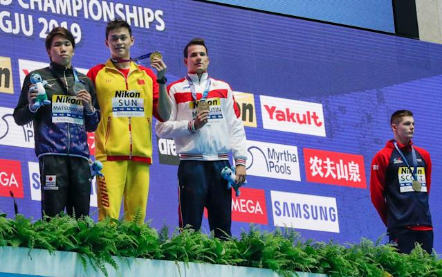 Britain's Duncan Scott refuses to stand with drug cheat Sun Yang at last summer's World Aquatics Championships - AP