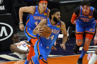 Oklahoma City Thunder guard Kenrich Williams (34) pushes the ball up court against the Phoenix Suns during the first half of an NBA basketball game, Wednesday, Jan. 27, 2021, in Phoenix. (AP Photo/Matt York)