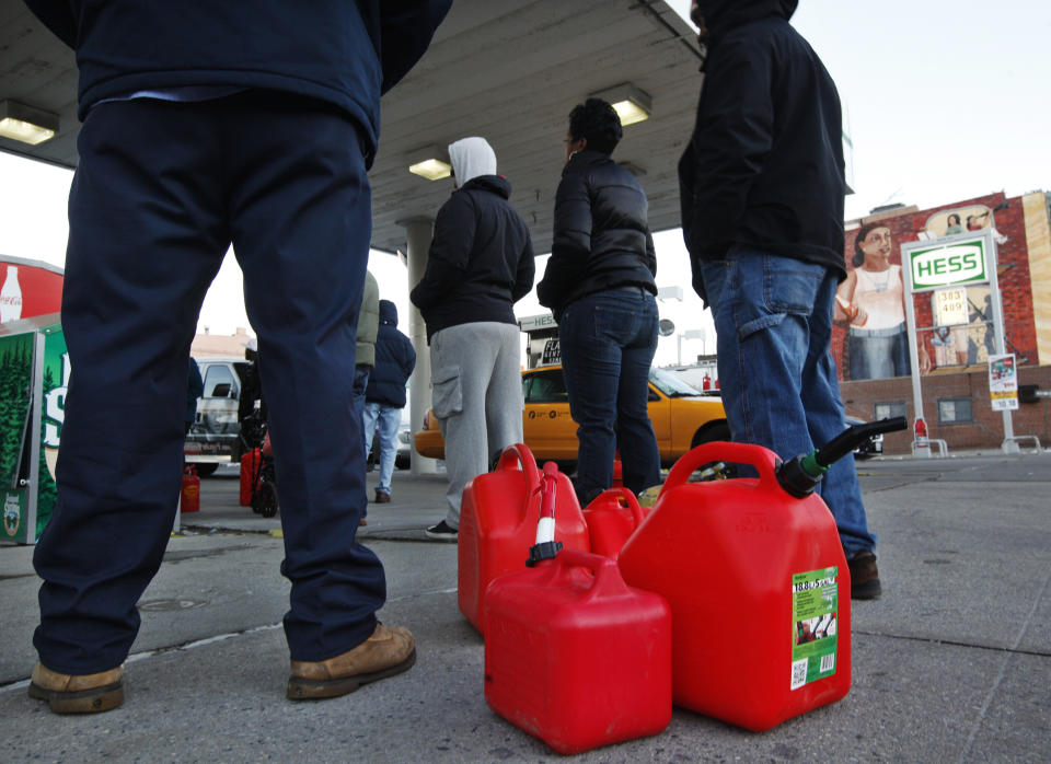 Customers wait in line for gas at a Hess fuelling station in Brooklyn, New York, November 9, 2012. Superstorm Sandy left a trail of destruction and despair in the U.S. Northeast, but it also exposed a surprising fault line in the ability of gasoline stations to keep fuel flowing. (REUTERS/Brendan McDermid)