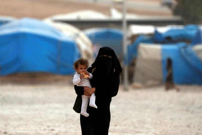 Thousands of people whose homes in Raqa were destroyed remain at a camp for the displaced in Ain Issa, a year after the Islamic State group was expelled from their city