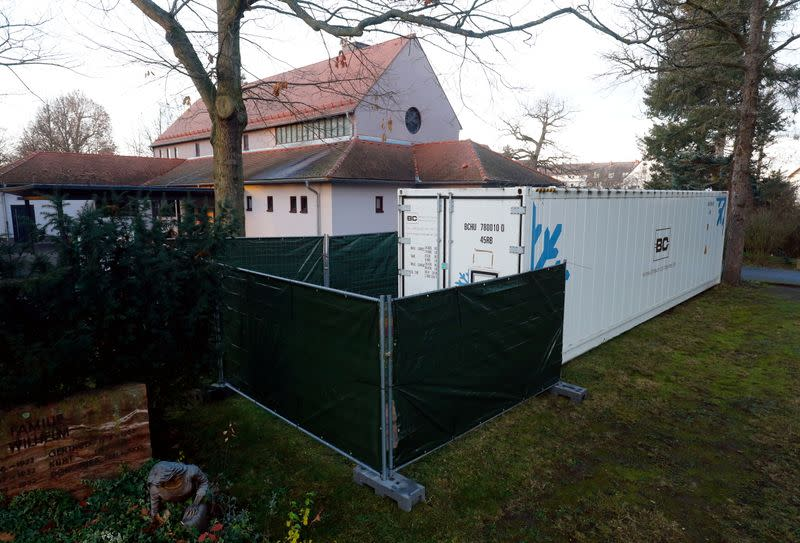 A freezer container is set up at the cemetery crematorium as the coronavirus disease (COVID-19) outbreak continues in Hanau