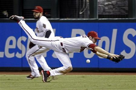 Arizona Diamondbacks center fielder A.J. Pollock dives but cannot make the catch of a ball hit by Los Angeles Dodgers' Michael Young during the eighth inning of their MLB National League baseball game in Phoenix, Arizona, September 17, 2013. REUTERS/Ralph D. Freso