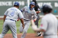 Toronto Blue Jays' Cavan Biggio, center, rounds third base on his solo home run during the third inning of a baseball game against the Boston Red Sox, Sunday, Aug. 9, 2020, in Boston. (AP Photo/Michael Dwyer)