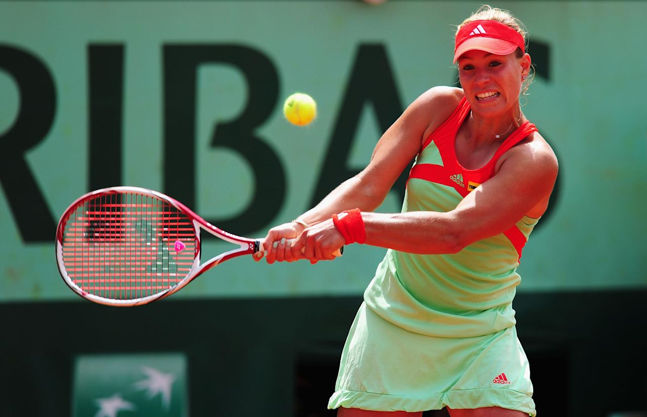 PARIS, FRANCE - JUNE 05:  Angelique Kerber of Germany in action in her women's singles quarter final match against Sara Errani of Italy during day 10 of the French Open at Roland Garros on June 5, 2012 in Paris, France.  (Photo by Mike Hewitt/Getty Images)