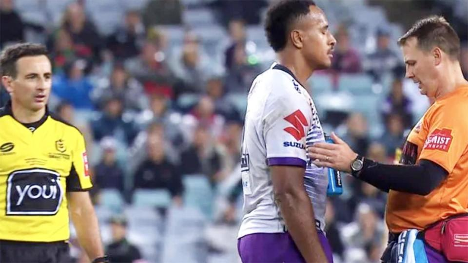 The Melbourne Storm trainer, pictured here checking on Felise Kaufusi.
