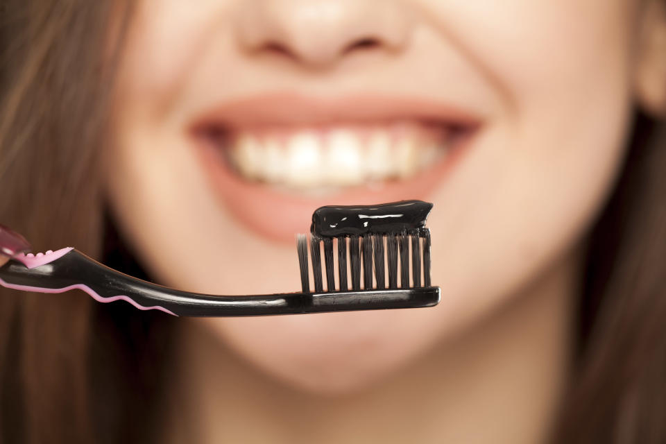 According to a dentist, activated charcoal can have a whitening effect on teeth. (Photo: Getty Images)