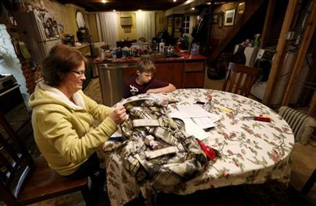 """<b class=""""credit"""">Julio Cortez/AP </b>Irene Sobolov and her son Joey at the kitchen table of the ground floor living area in Hoboken, N.J., that is being called a """"basement"""""""