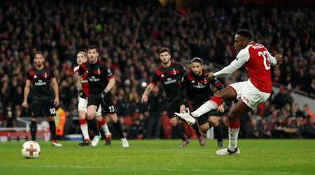 Arsenal's Danny Welbeck scores their first goal from the penalty spot. Action Images via Reuters/John Sibley