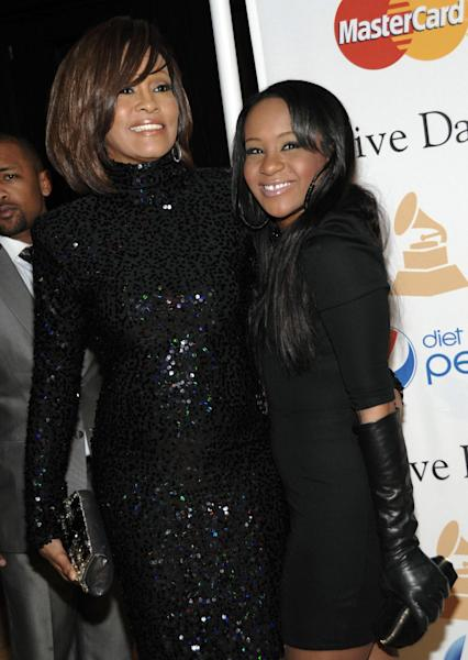 """FILE - In this Feb. 12, 2011 file photo, singer Whitney Houston, left, and her daughter Bobbi Kristina arrive at the Pre-Grammy Gala & Salute to Industry Icons with Clive Davis honoring David Geffen in Beverly Hills, Calif. A lawyer for Whitney Houston says her will is a """"straightforward"""" case and he expects no complications. Houston's will was filed in probate court in Atlanta Wednesday. It revealed that the late superstar left all her assets to her only child, 19-year-old Bobbi Kristina. Her sister-in-law and manager, Pat Houston, was named as the administrator of the estate. (AP Photo/Dan Steinberg)"""