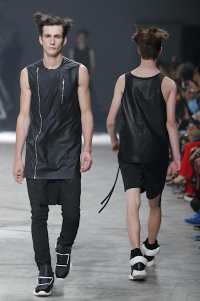 Models wear creations by fashion designer Rick Owens as part of his men's fashion Spring-Summer 2014 collection, presented Thursday, June 27, 2013 in Paris. (AP Photo/Francois Mori)