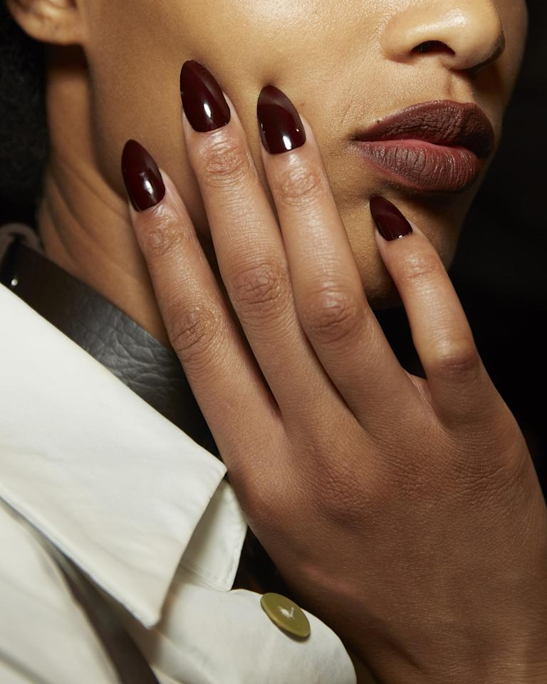 """Who said Essie's <a href=""""https://shop-links.co/1684506240546067066"""" rel=""""nofollow"""">Wicked</a> was reserved for fall? (Even though it <em>is</em> <a href=""""https://www.glamour.com/gallery/best-fall-nail-polish-colors?mbid=synd_yahoo_rss"""">one of my favorite colors</a> come September.) What I loved about the shade at Tommy is that they mixed it with <a href=""""https://shop-links.co/1684506276701784043"""" rel=""""nofollow"""">Berry Naughty</a> to warm up the hue just a hint. <em>—Lindsay Schallon, senior beauty editor</em>"""