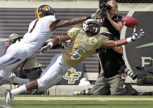 Missouri defensive back Kip Edwards (1) is called for pass interference as he breaks up a pass intended for Central Florida wide receiver Rannell Hall (6) during the first half of an NCAA college football game, Saturday, Sept. 29, 2012, in Orlando, Fla. (AP Photo/John Raoux)