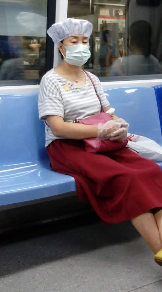 Woman dons shampoo hat onboard Singapore train. Photo: Justin Lim/Facebook