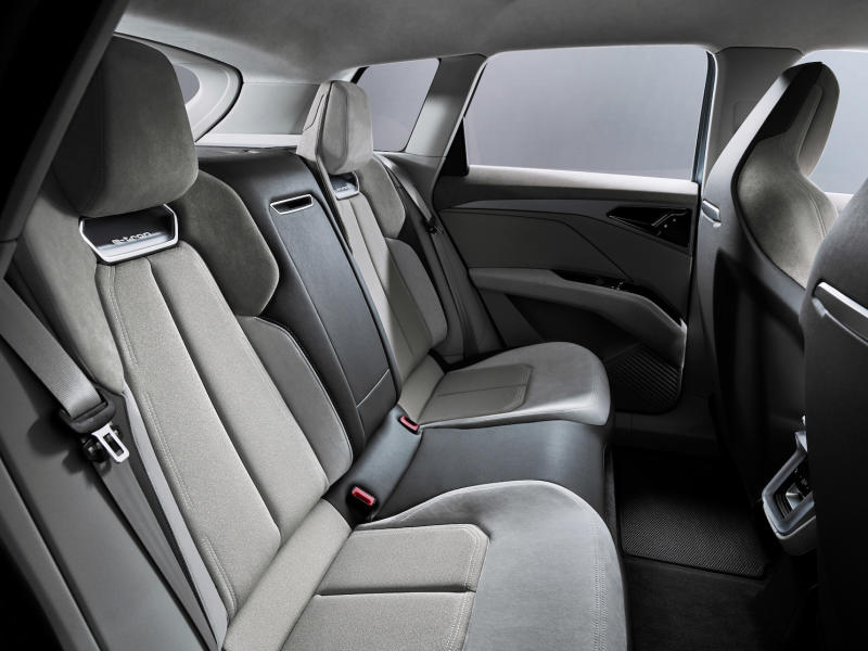 A view of the rear seats of the e-tron Q4 Concept, showing ample leg and headroom for adult passengers.
