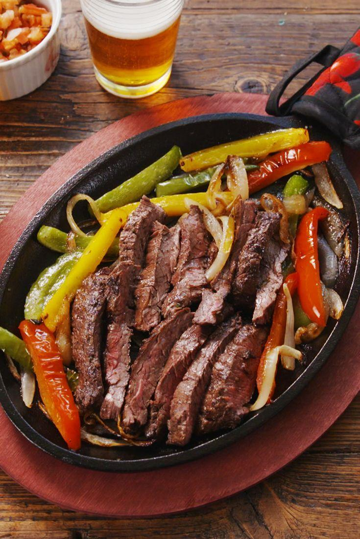 """<p>Don't you love when the steak arrives at the table sizzling in a hot skillet? Now you can recreate the experience at home.</p><p>Get the recipe from <a href=""""https://www.delish.com/cooking/recipe-ideas/a20891589/sizzling-steak-fajitas-recipe/"""" rel=""""nofollow noopener"""" target=""""_blank"""" data-ylk=""""slk:Delish"""" class=""""link rapid-noclick-resp"""">Delish</a>.</p>"""