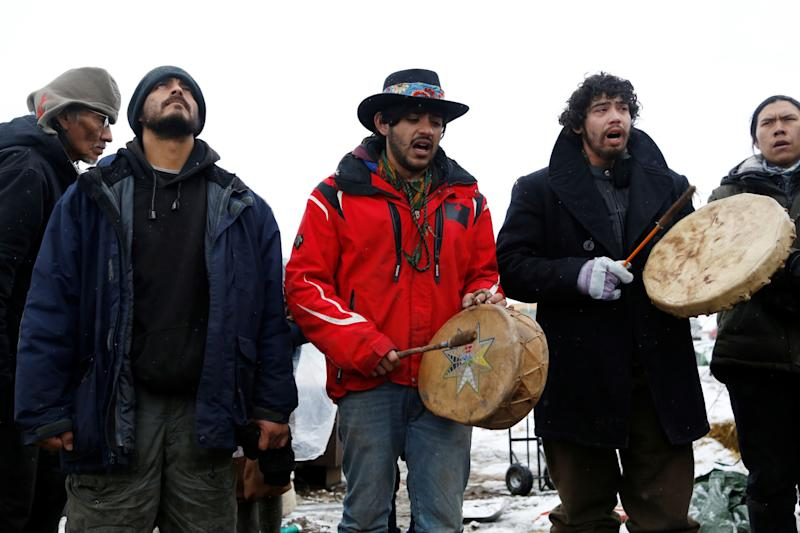 <p>Members of the Cheyenne River Sioux Tribe and others sing as they prepare to evacuate the main opposition camp against the Dakota Access oil pipeline near Cannon Ball, North Dakota, U.S., February 22, 2017. (Terray Sylvester/Reuters) </p>