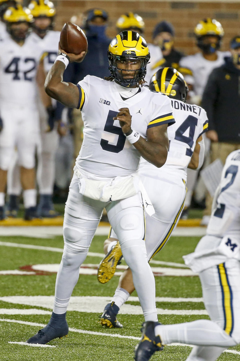 Michigan quarterback Joe Milton passes against Minnesota in the first quarter of an NCAA college football game Saturday, Oct. 24, 2020, in Minneapolis. (AP Photo/Bruce Kluckhohn)