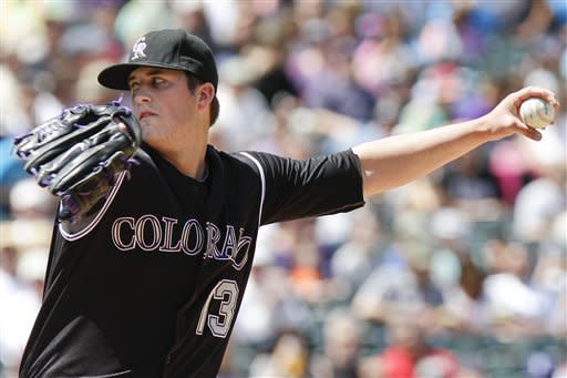 Colorado Rockies starting pitcher Drew Pomeranz (13) delivers against the Los Angeles Dodgers during the first inning of a baseball game, Wednesday, May 2, 2012, in Denver. (AP Photo/Barry Gutierrez)