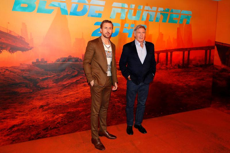 """FILE PHOTO: Cast members Ryan Gosling and Harrison Ford attend a photocall for the film """"Blade Runner 2049"""" in Paris"""