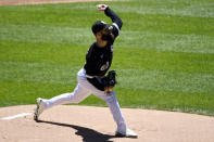 Chicago White Sox starting pitcher Dallas Keuchel (60) delivers during the first inning in the first baseball game of a doubleheader against the Baltimore Orioles, Saturday, May 29, 2021, in Chicago. (AP Photo/Matt Marton)