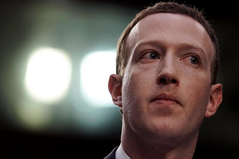 Facebook, whose CEO Mark Zuckerberg is seen here, said it set aside some $3 billion for an expected settlement with US regulators over its handlings of private user data (AFP Photo/ALEX WONG)