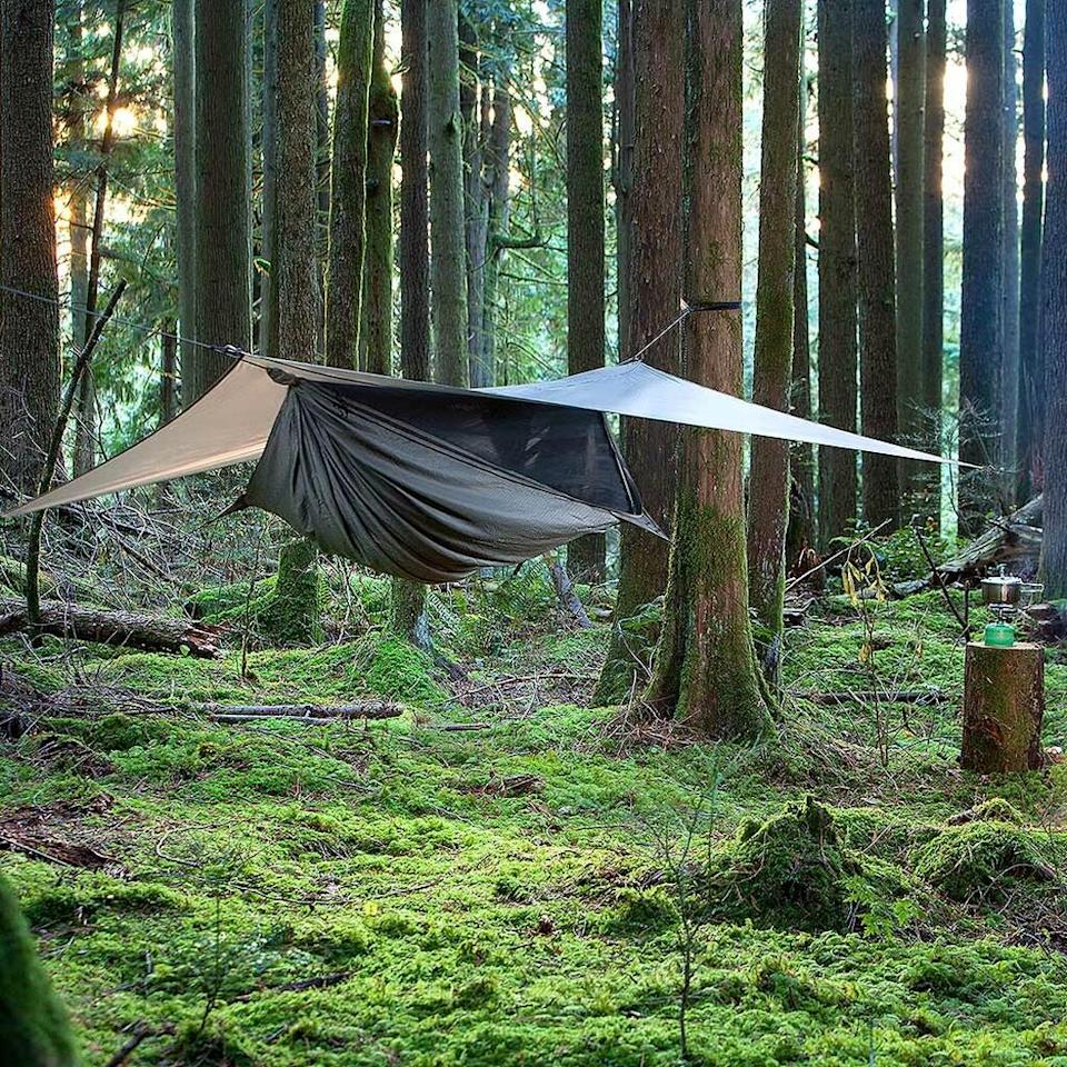 """<h2>Best Hammock For Camping</h2><br><h3>Hennessy Hammock Expedition Asym Zip Hammock</h3><br><strong>The Hype:</strong> 4.4 out of 5 stars and 48 reviews<br><br><strong>Reviewers say:</strong> """"I've had the Hennessy for over a year and this thing never fails... This hammock is quick to set up and has a low signature. I've had some really nasty downpours and I never got wet.""""<br><br><em>Shop</em> <strong><em><a href=""""https://www.rei.com/product/799606/hennessy-hammock-expedition-asym-zip-hammock"""" rel=""""nofollow noopener"""" target=""""_blank"""" data-ylk=""""slk:Hennessey Hammock"""" class=""""link rapid-noclick-resp"""">Hennessey Hammock</a></em></strong><br><br><strong>Hennessy Hammock</strong> Expedition Asym Zip Hammock, $, available at <a href=""""https://go.skimresources.com/?id=30283X879131&url=https%3A%2F%2Fwww.rei.com%2Fproduct%2F799606%2Fhennessy-hammock-expedition-asym-zip-hammock"""" rel=""""nofollow noopener"""" target=""""_blank"""" data-ylk=""""slk:REI"""" class=""""link rapid-noclick-resp"""">REI</a>"""