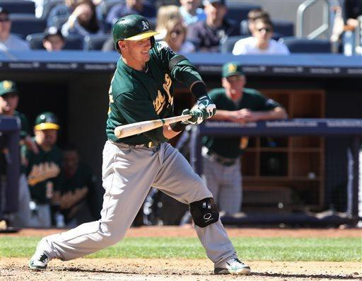 Oakland Athletics Josh Donaldson hits a solo home run in the eighth inning of an MLB American League baseball game against the New York Yankees in New York on Sunday, May 5, 2013. (AP Photo/Peter Morgan)