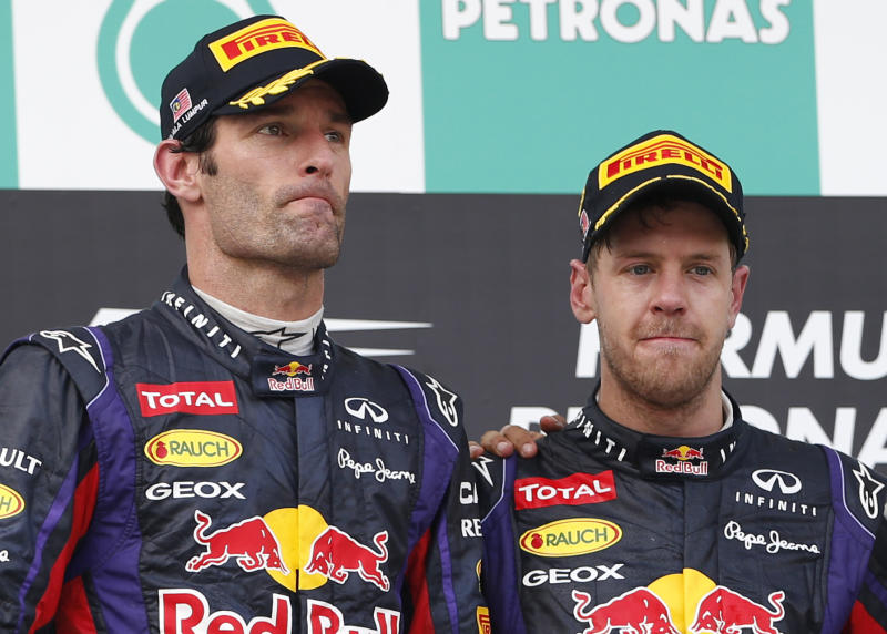 """FILE - This is a Sunday, March 24, 2013 file photo of Red Bull driver Mark Webber left. and Red Bull teammate Sebastian Vettel of Germany as they pose together after awards ceremony for the Malaysian Formula One Grand Prix at Sepang, Malaysia. Vettel won the race, followed by second-placed Webber . Red Bull driver Mark Webber says he is leaving Formula 1 to race Porsche sports cars from next season. The Australian's website says in a statement from Porsche that he has signed a contract with the German company """"that extends over several years"""" and that he will compete in the Le Mans 24 Hours and World Endurance Championship next year. (AP Photo/Vincent Thian, File)"""