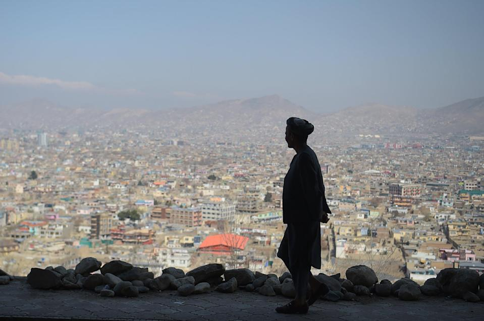 An Afghan man walks during the first day of the Nowruz (Noruz), or Persian New Year, in a hilltop overlooking of Kabul on March 21, 2018. (AFP via Getty Images)