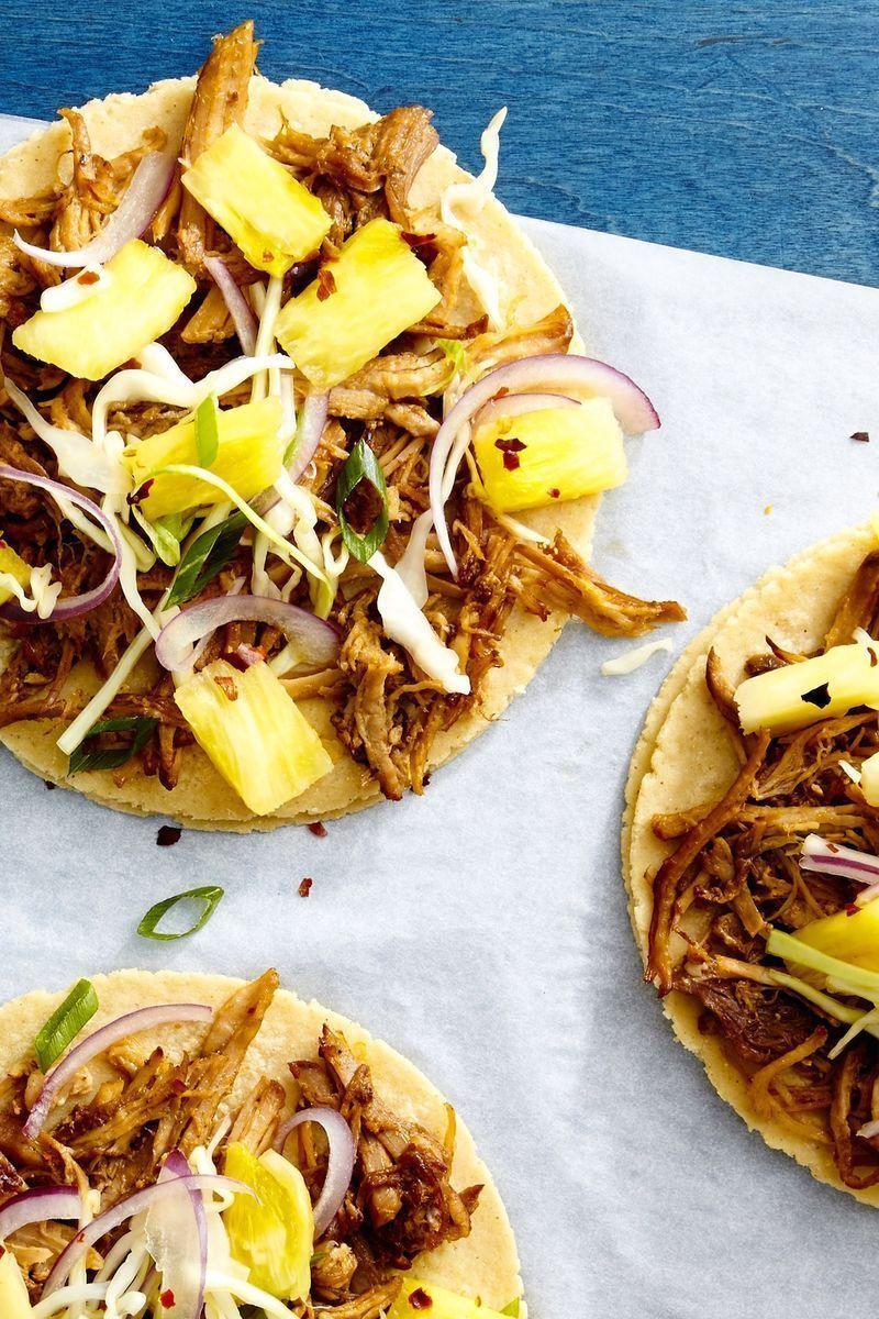 "<p>You'll want to use the pineapple slaw on everything.</p><p>Get the <a href=""https://www.delish.com/uk/cooking/recipes/a29186647/pulled-pork-tacos-with-pineapple-slaw-recipe/"" rel=""nofollow noopener"" target=""_blank"" data-ylk=""slk:Pulled Pork Tacos"" class=""link rapid-noclick-resp"">Pulled Pork Tacos</a> recipe. </p>"