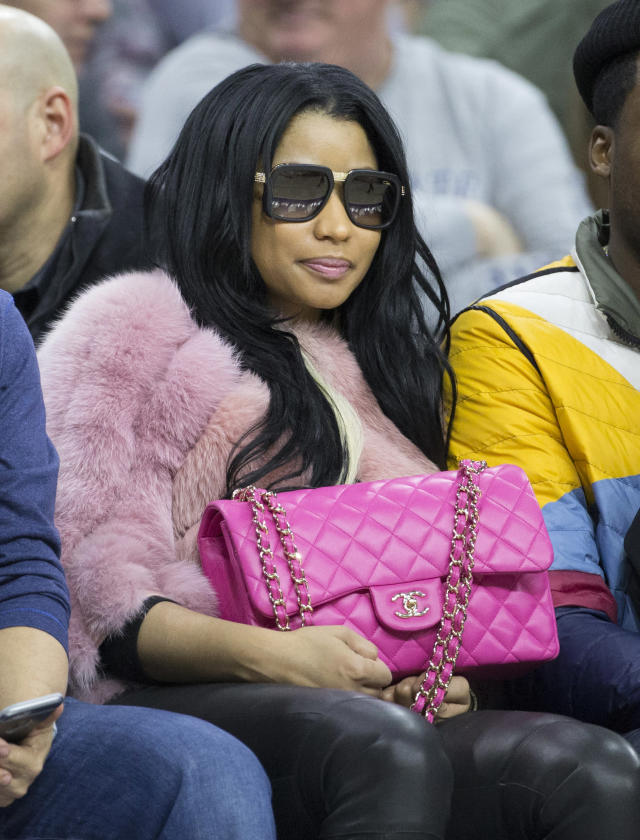 Pink lady Nicki Minaj looks on during the game between the Phoenix Suns and Philadelphia 76ers on Jan. 26, 2016. (Photo: Mitchell Leff/Getty Images)