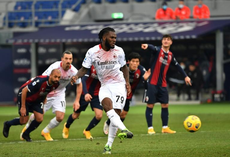 Franck Kessie (C) converts a penalty for AC Milan in a victory over Bologna