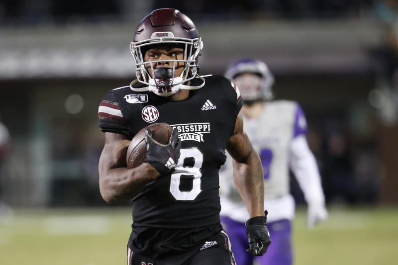 FILE — In this Nov. 23, 2019, file photo, Mississippi State running back Kylin Hill plays against Abilene Christian in an NCAA college football game in Starkville, Miss. Mississippi State is scheduled to play Louisville in the Music City Bowl in Nashville Dec. 30. (AP Photo/Rogelio V. Solis, File)
