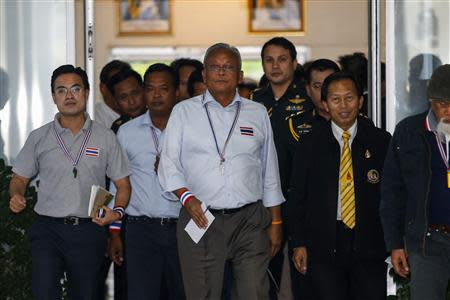 Thaugsuban leaves The Royal Thai Armed Forces Headquarters in Bangkok