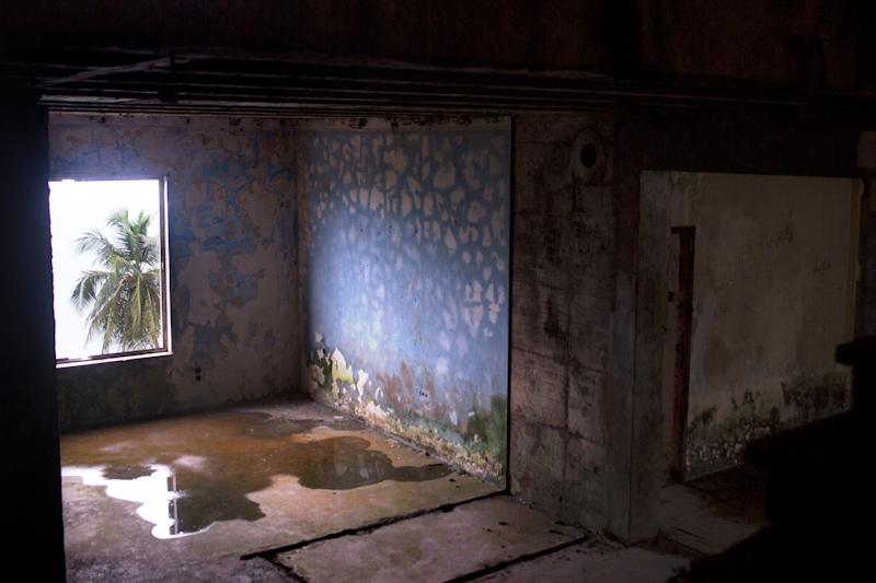 A room in the abandoned Ducor Hotel in Monrovia, Liberia. The hotel was a location where some of the girls said they were raped. At one time, it was a four star hotel, one of the finest in all of Africa, but if fell into disrepair during Liberia's civil war