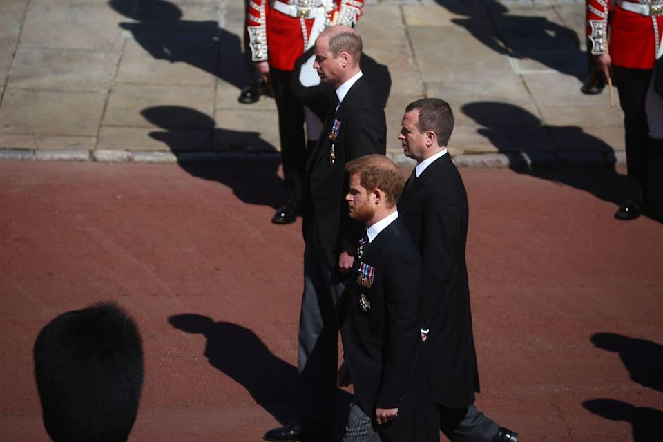 <p>Prince William, Peter Phillips, and Prince Harry walk together in the royal procession. </p>
