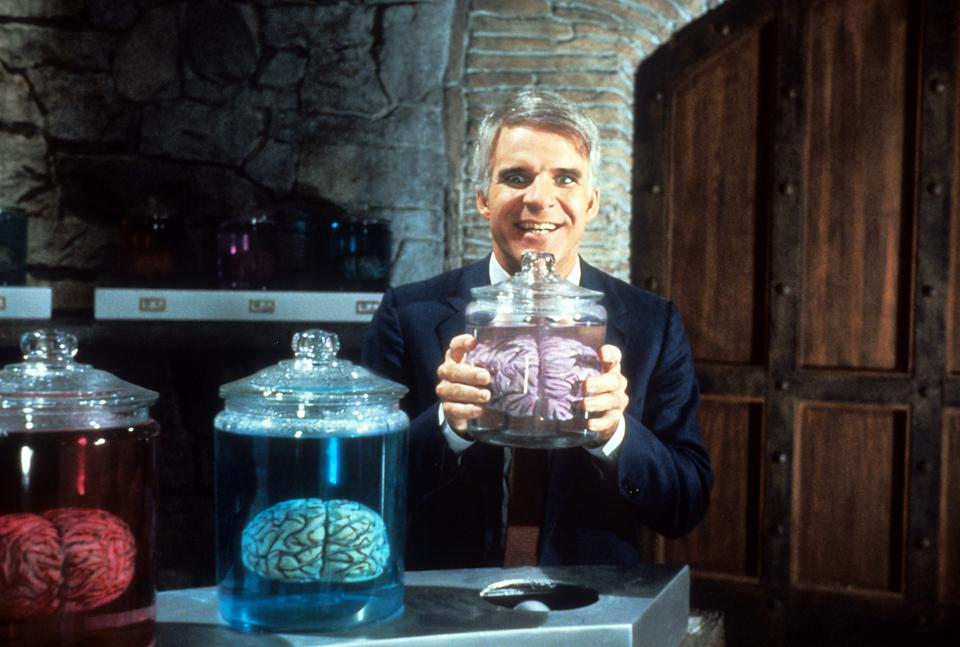 Steve Martin holding jar of brains in a scene from the film 'The Man With Two Brains', 1983. (Photo by Warner Brothers/Getty Images)