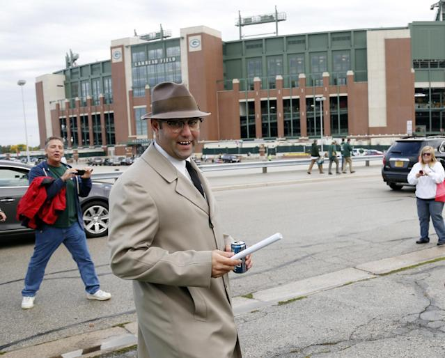 Bill Stamm dresses up like former Green Bay Packers coach Vince Lombardi before an NFL football game against the Detroit Lions Sunday, Oct. 6, 2013, in Green Bay, Wis. (AP Photo/Jeffrey Phelps)