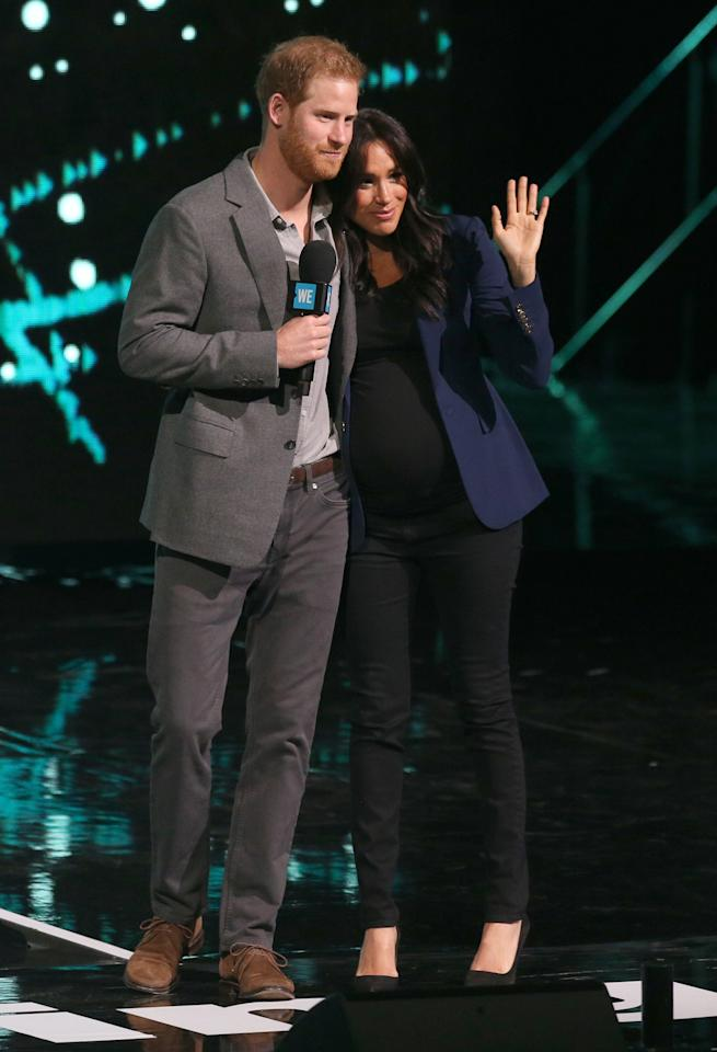 <p>For a surprise appearance at WE Day with Harry, Meghan dressed her bump in a black Misha Nonoo t-shirt, Rag & Bone maternity jeans and a £527.37 Smythe blazer. <em>[Photo: PA]</em> </p>