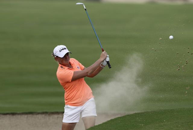 Stacy Lewis of the U.S. plays a bunker shot on the 14th hole during the 2nd round of Dubai Ladies Masters golf tournament in Dubai, United Arab Emirates, Thursday, Dec. 5, 2013. (AP Photo/Kamran Jebreili)
