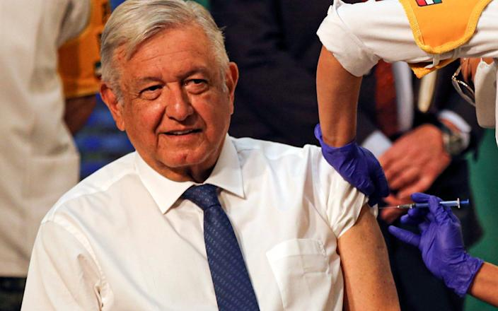 Mexican President Andres Manuel Lopez Obrador gets a shot of the AstraZeneca vaccine for COVID-19 during his daily, morning news conference at the presidential palace - AP Photo/Fernando Llano