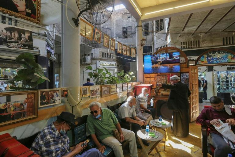 Iraqis sit at a traditional cultural coffee shop, one of several gathering spots for the country's intellectuals, in the capital Baghdad's al-Rashid street