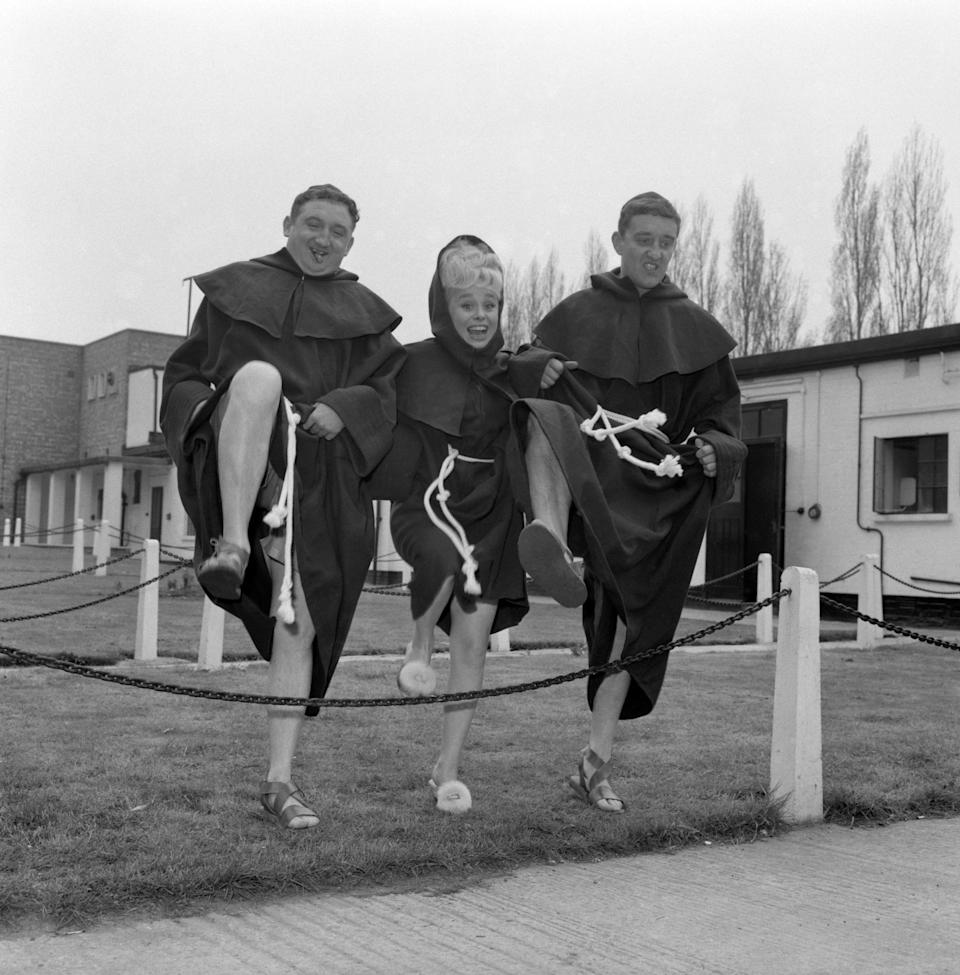 """Ronald Fraser, left, Barbara Windsor, and Bernard Cribbens, three of the crooks in the new film """"Crooks and Cloisters"""", being made at Elstree Studios, Hertfordshire."""