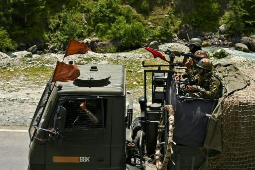 India is sending hundreds of extra troops towards the Chinese border, sources told AFP -- these soldiers are riding in a convoy along a highway leading towards Leh, bordering China