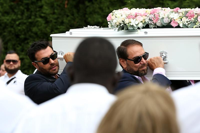 Pallbearers can be seen carrying the coffins of the children as a crowd of 2000 people watch on. Source: AAP/Danny Casey